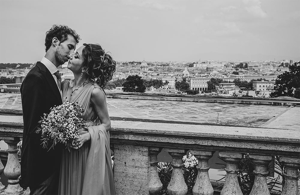 Recently married couple in Rome overlooking the city